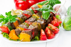 Grilled meat on skewers with vegetables Royalty Free Stock Photography