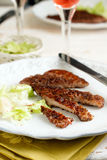 Grilled meat sliced. Grilled meat in sumac with salad Royalty Free Stock Photo