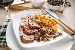 Grilled meat slices with champignon mushrooms and yellow peppers Royalty Free Stock Photo