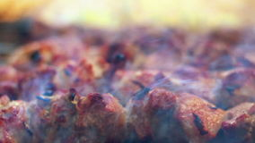 Grilled meat with smoke. Closeup. Arabic food. Cooked meat with crust stock video footage