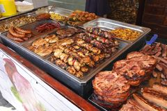Grilled meat specialties. In Sighisoara Medieval Festival Romania 26.7.2018 stock image