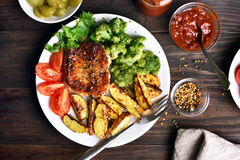 Grilled meat steak, barbecue with vegetables Royalty Free Stock Photography