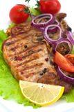 Grilled meat steak with herbs Stock Photos