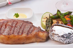 Grilled meat steak and vegetables Royalty Free Stock Image