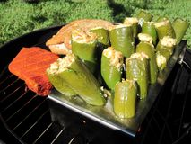 Grilled Meat and Stuffed Jalapenos Stock Image