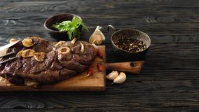 Grilled meat on a table. Grilled lamb meat with garlic on a wooden board stock video