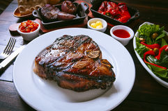 Grilled meat. Tasty and golden piece of grilled meat Royalty Free Stock Photo
