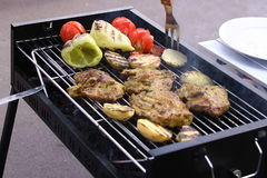 Grilled meat and tomatoes Stock Photo