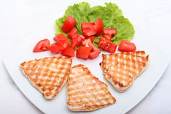 Grilled meat with tomatoes Stock Images
