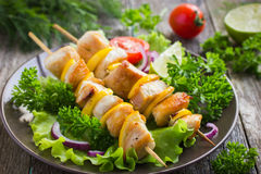 Grilled meat and vegetable kebabs Stock Photos