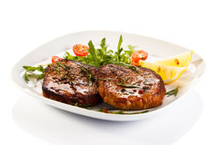 Grilled beefsteaks Stock Images