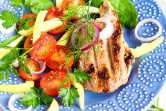 Grilled meat with vegetable salad Royalty Free Stock Photography