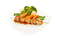Grilled meat and vegetables Stock Photos