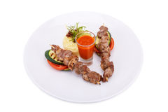 Grilled meat and vegetables. Isolated on white Royalty Free Stock Image