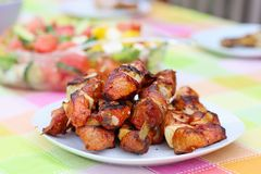 Grilled meat and vegetables on picnic table Stock Image