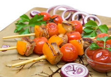 Grilled meat and vegetables on the plate closeup Royalty Free Stock Photography