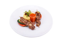 Grilled meat and vegetables with sauce. Isolated on white Royalty Free Stock Image