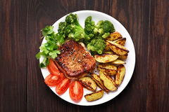 Grilled meat with vegetables, top view Stock Photos