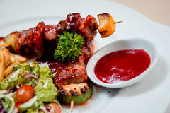 Grilled meat on the white plate Stock Images