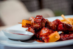 Grilled meat on the white plate Royalty Free Stock Image