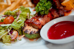 Grilled meat on the white plate Royalty Free Stock Images