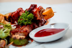 Grilled meat on the white plate Stock Photography