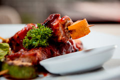 Grilled meat on the white plate Royalty Free Stock Photography