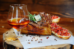 Grilled meat on a wooden background Royalty Free Stock Photo