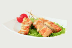Grilled meat on wooden sticks Royalty Free Stock Photo