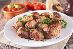 Grilled meatball and herbs Royalty Free Stock Image