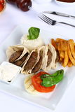 Grilled meatball. Grilled Turkish meatball on dinner plate Royalty Free Stock Photos