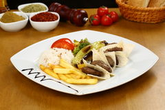 Grilled meatball. Grilled Turkish meatball on white dinner table Royalty Free Stock Image