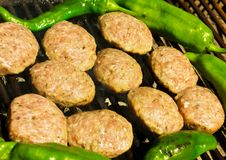 Grilled meatballs and peppers royalty free stock images