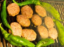 Grilled meatballs and peppers stock images