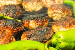 Grilled meatballs and peppers Royalty Free Stock Photo