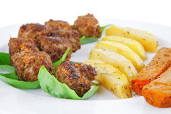 Grilled meatballs on white Stock Photography