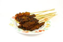 Grilled Meats Skewered on Bamboo Sticks stock images