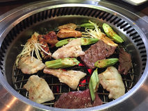 Grilled meats with vegetables Stock Image