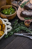 Grilled medium rare beef steak with herbs on rustic table Royalty Free Stock Photography