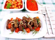 Grilled mince rolls with giant white beans Royalty Free Stock Photos