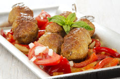 Grilled minced meat balls on a skewer Royalty Free Stock Images