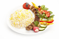 Grilled Minced Meat Lamb Skewer Served With Rice. And herb on a plain plate. Fusion food concept and Persian traditional kebab koobideh or kubide. High angle stock photography