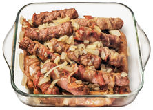 Grilled Minced Meat Loaves Cevapcici With Chopped Onion In Glass Baking Pan Isolated On White Background Stock Images