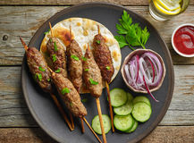 Grilled minced meat skewers kebabs. On wooden table, top view Stock Image