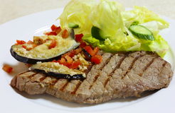 Grilled minute steak side view Royalty Free Stock Image