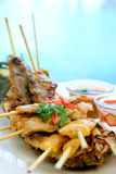 Grilled mixed satay. Grilled meats satay displayed on pineapple Royalty Free Stock Images