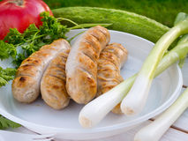 Grilled Munich sausages on the disposable white plastic plate Stock Images