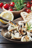 Grilled mushroom with lemon and rosemary Stock Photography