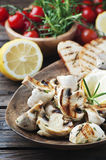 Grilled mushroom with lemon and rosemary Royalty Free Stock Photography