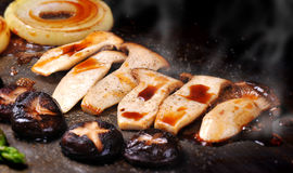 Grilled mushroom and onion with Japanese source Stock Images